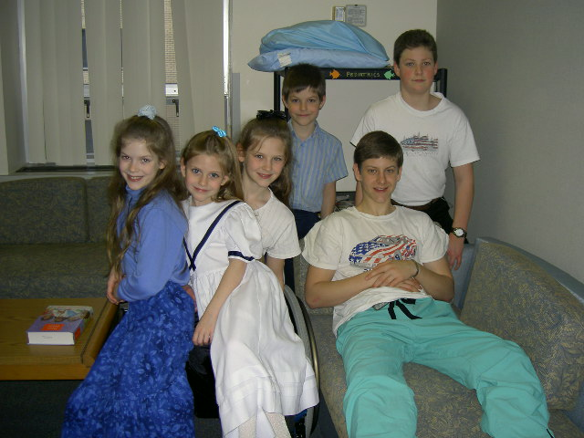 Jason visits with his brothers & sisters in The Family Room at the hospital